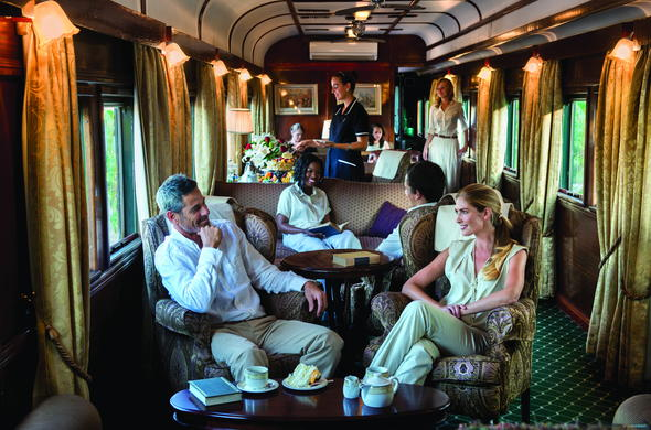 Guests relaxing in the car train lounge.