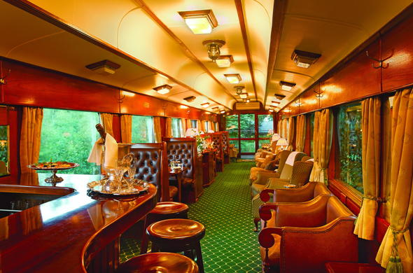 Relax in the Rovos Rail train lounge.